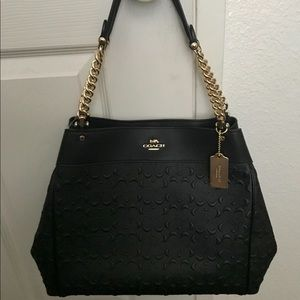 Coach black purse never used